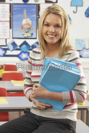portrait of female teacher sitting at