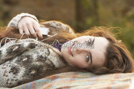 portrait of beautiful teenage girl outdoors