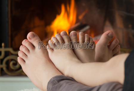 childrens feet are heated by an