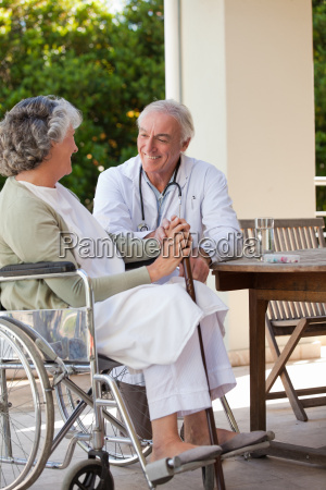senior doctor talking with his mature
