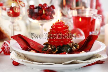 table setting for christmas with fresh