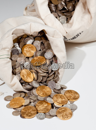 silver and gold coins in bullion