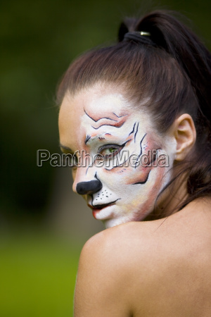 young woman with tigress face art