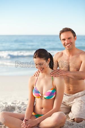 man applying sun cream on his