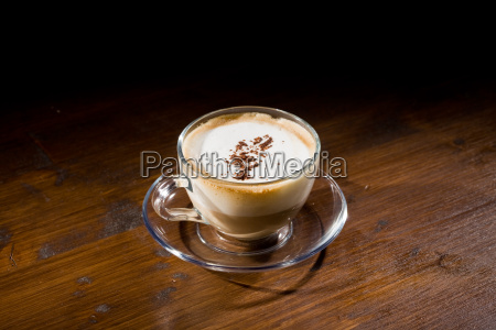 cappuccino on wood table