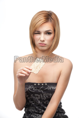 young woman tasting healthy bread and