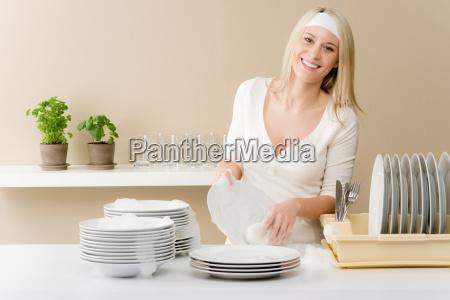 modern kitchen happy woman washing