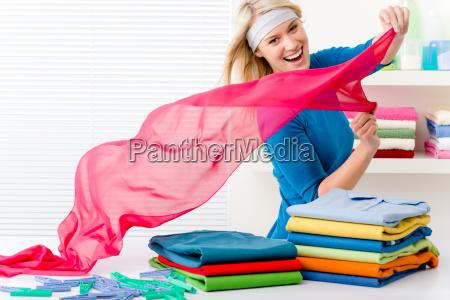 laundry woman folding clothes