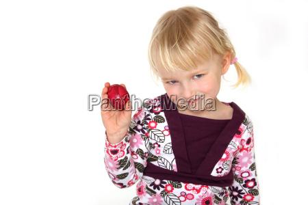 girl holding easter egg