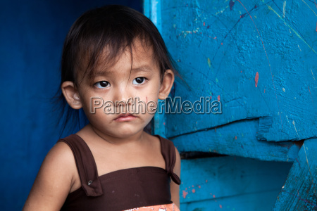 young girl living in poverty in
