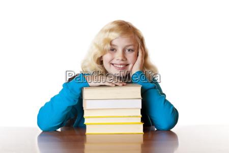 schoolgirl happy with books
