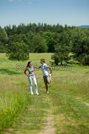 young man and woman exercising in