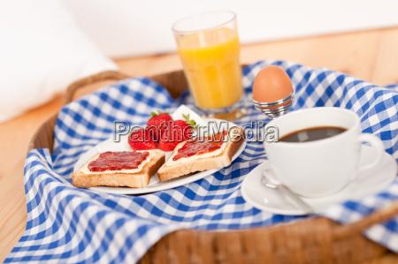 homemade breakfast on wicker tray with
