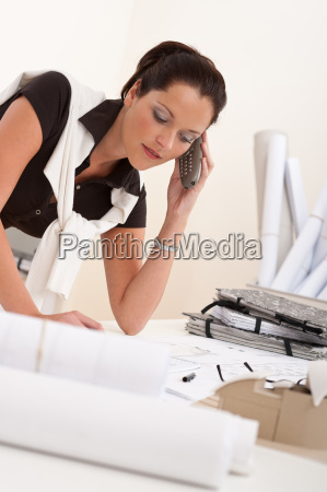 female architect with telephone