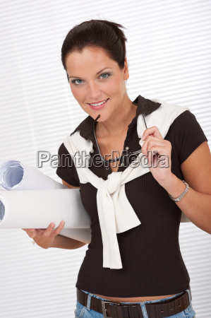 smiling female architect holding plans and