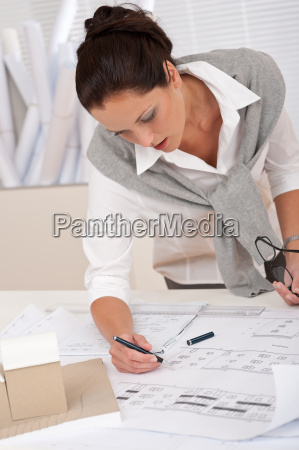 female architect watching plans at the