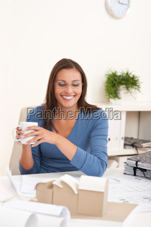 brown hair female architect sitting at