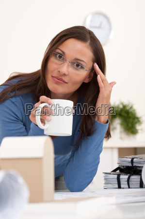 attractive female architect working at the