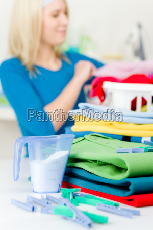 laundry clothespin woman folding clothes
