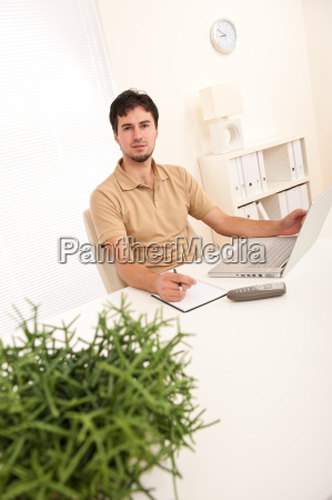 successful modern businessman with laptop