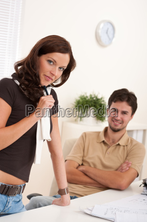 young woman and man at office