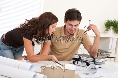 young man and woman working at