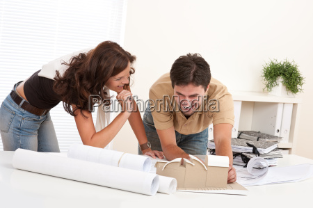 young, man, and, woman, working, at - 4432227