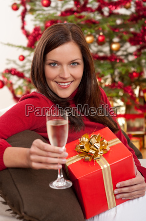 smiling woman with christmas present and