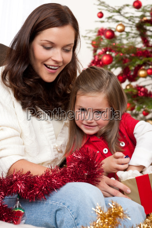 mother with child opening present