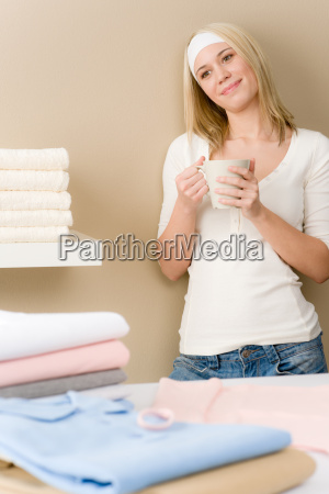 laundry ironing woman coffee break