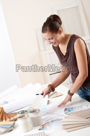 young female designer at office with