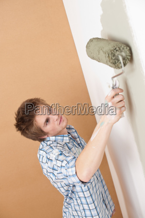 home improvement young man with paint