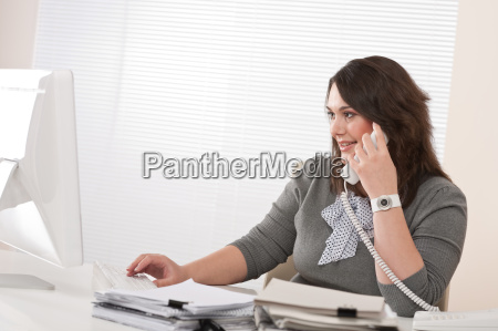 attractive executive woman on phone at