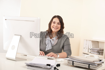 young attractive business woman working at