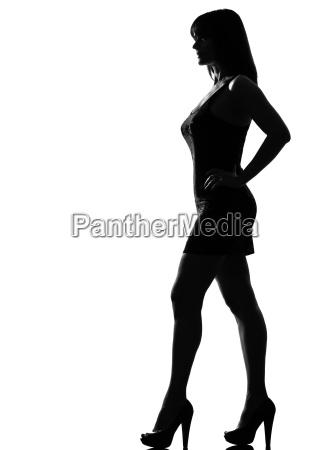 stylish silhouette woman standing profile full