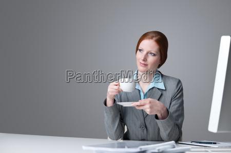 successful business woman having coffee break