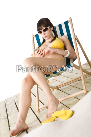 beach woman listen to music