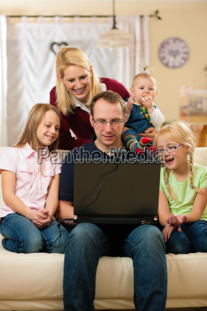 family in front of computer to