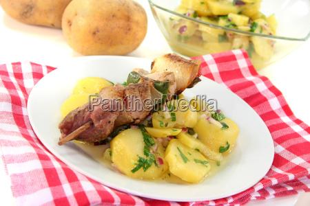 schaslik spit with potato salad