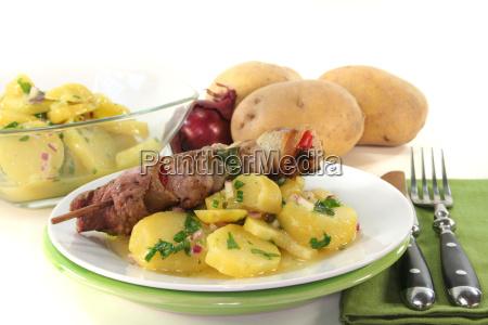 schaslikspiess with potato salad