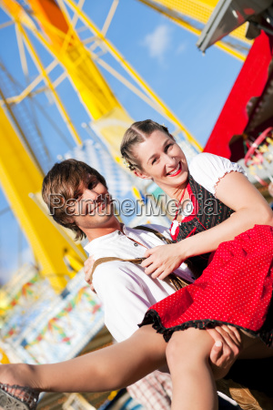 couple in costume at volksfest or