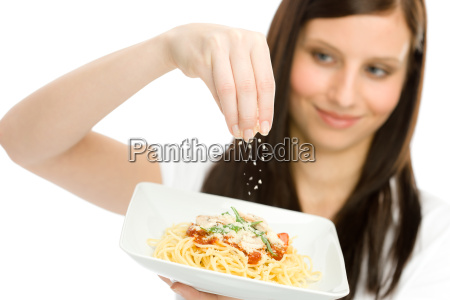 italian food woman spaghetti grated