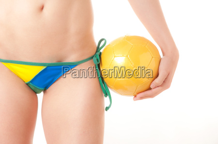 brazilian bikini bottom model holding soccer