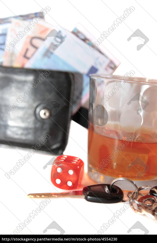 Stock image 4554230 - whiskey keys dice and cash