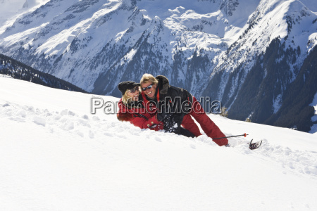 love couple embracing in snow