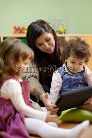 teacher reading fairy tale to children