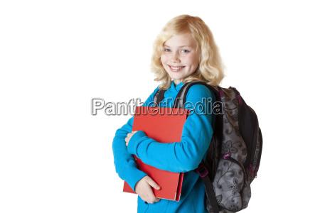 schoolgirl with schoolbag and backpack