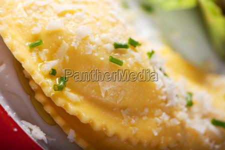 closeup of fresh ravioli with parmesan