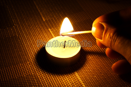 candle ignition with match