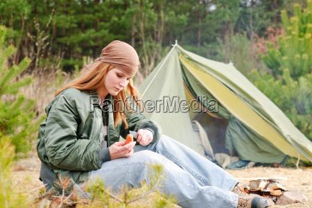 camping woman tent nature cut sausage